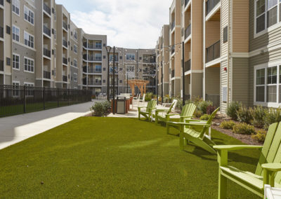 Landscaped outdoor space with chairs at The Station at Willow Grove