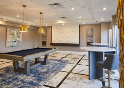 Indoor club room with pool table at The Station at Willow Grove apartments