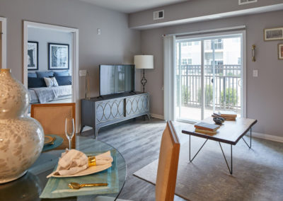 Furnished living space with wood-style flooring at Willow Grove apartments