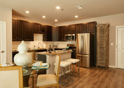 Chef-caliber kitchen with espresso cabinetry at The Station at Willow Grove