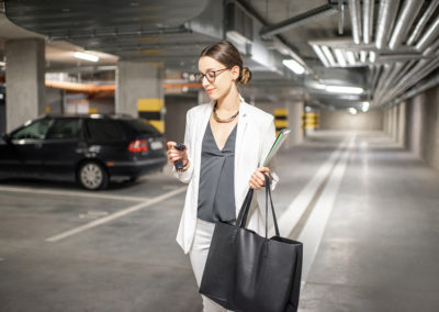 A woman walking through a parking garage