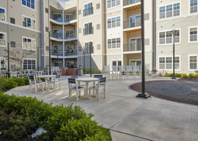 Furnished courtyard with fireplace at The Station at Willow Grove